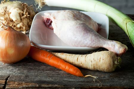 raw chicken leg and vegetables Stock Photo - 10829332