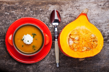 pumpkin soup and a half hokkaido on wood Stock Photo