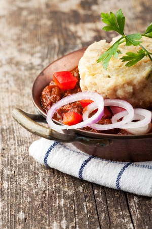 goulash with dumpling on a wooden plank Stock Photo - 10981236