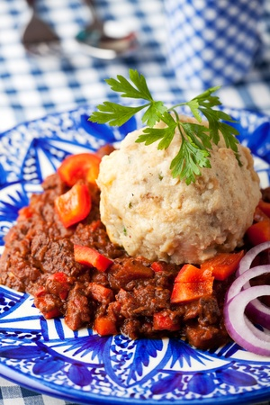 goulash with dumpling on a blue plate Stock Photo - 10981226