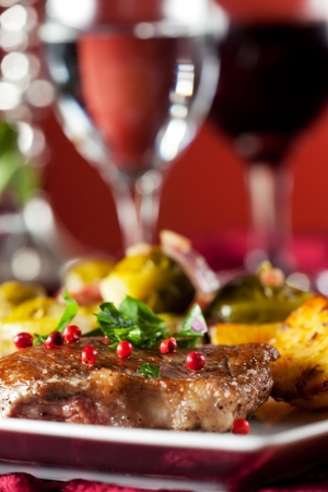 brussel: steak with red pepper corns and brussel sprouts  Stock Photo
