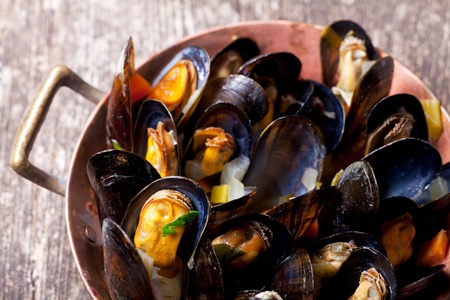cooked mussels in a copper pot  photo