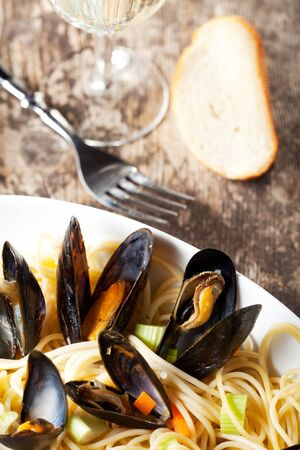 cooked mussels and spaghetti with wine sauce photo