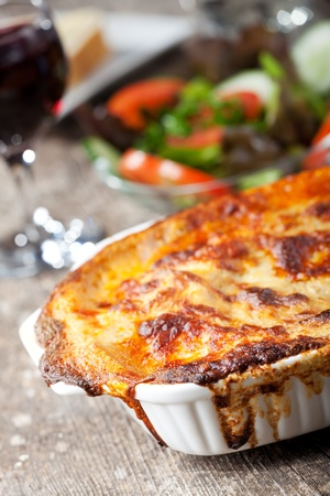 fresh lasagna dish in a baking dish  photo