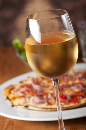 onion tart with ham and fresh white wine  photo