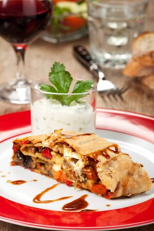 vegetable strudel on a plate with salad  photo