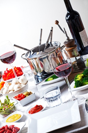 table with fondue set and ingredients