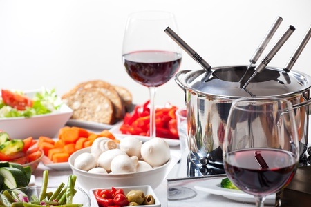 table with fondue set and ingredients  photo
