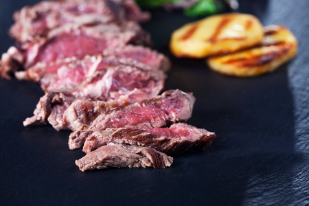 sliced sirloin steak on a slate Stock Photo - 11934865