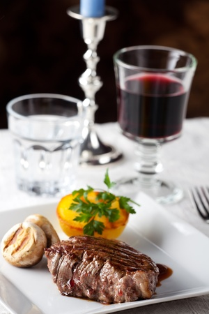steak with grilled potato on a plate Stock Photo - 11960901