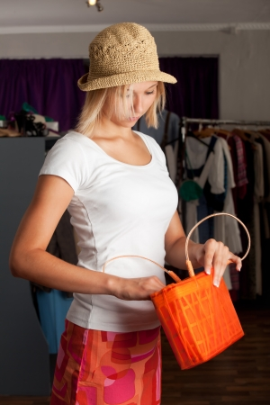 girl with a straw hat in a boutique  Stock Photo - 16335575