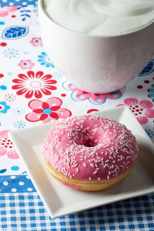 pink donut and a cup of cappuccino Stock Photo - 12615617