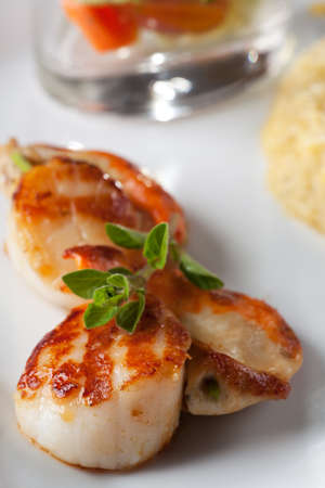 pair of grilled scallops  photo