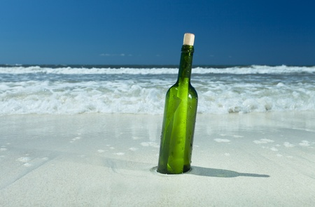 message in a bottle on a beach Stock Photo - 13814068