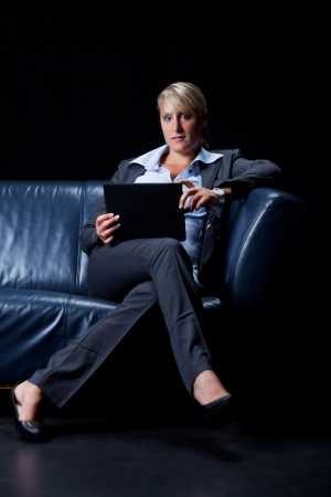 business woman with a table pc  Stock Photo - 16335380