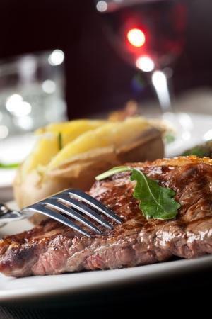 fork on a grilled steak