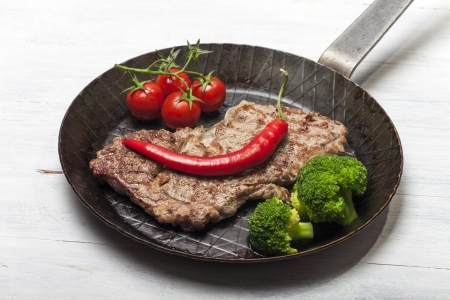 grilled steak in an iron pan Stock Photo - 14258538
