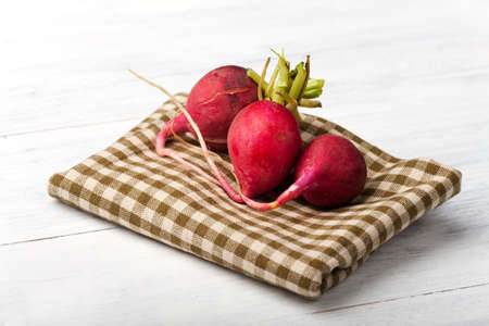 three radishes on wood  Stock Photo - 14379335