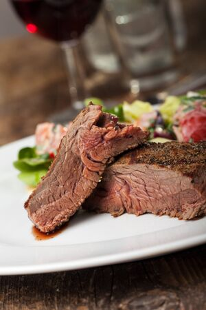 halves of a steak on a plate  Stock Photo - 14626251