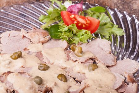 italian vitello tonnato on a glass plate  photo