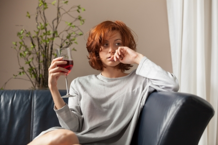 beautiful redhead with wine  Stock Photo - 16335587