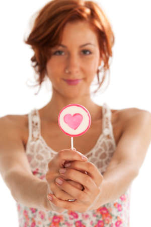 beautiful redhead with a lollipop Stock Photo - 16335576
