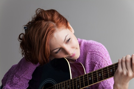 beautiful redhead with a guitar  Stock Photo - 16335582