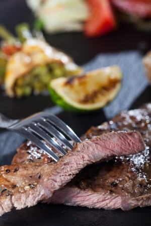 slices of steak with a fork  Stock Photo - 14758618