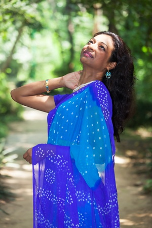 young indian woman in a saree outdoors Stock Photo - 16335463