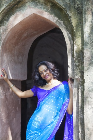 young indian woman in a saree outdoors  photo