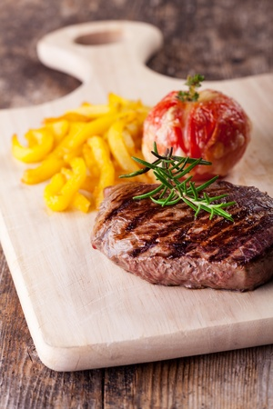 grilled steak with fries and tomato  photo
