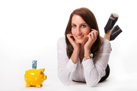 business woman with a piggybank  Stock Photo - 16335384
