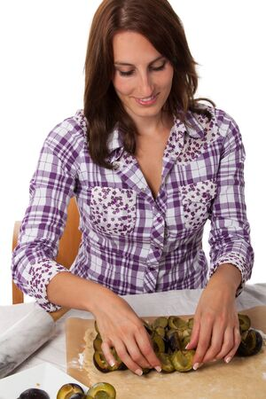 woman baking a bavarian plumcake  Stock Photo - 16335387