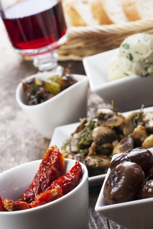 different italian antipasti and red wine  photo