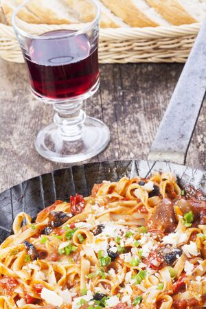 Mediterranean pasta dish in an iron pan  Stock Photo - 16259584