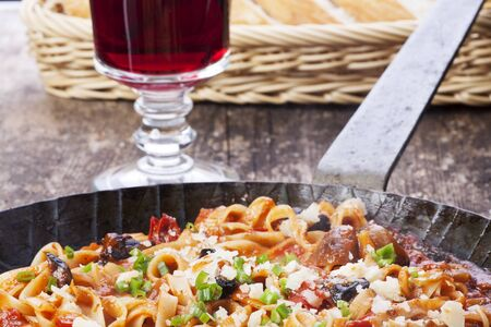 Mediterranean pasta dish in an iron pan  Stock Photo - 16259581