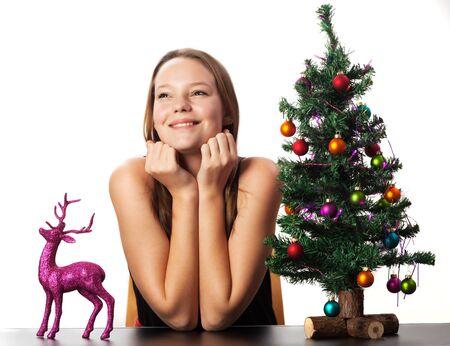 woman decorating a christmas tree Stock Photo - 16335391