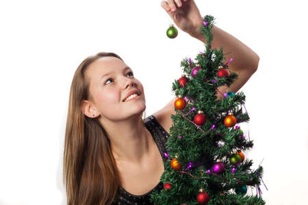 woman decorating a christmas tree  photo