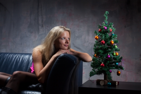 young woman in a corsage and a christmas tree  Stock Photo - 16335428