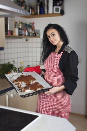 woman baking a gingerbread man  photo