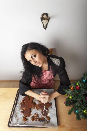 woman baking a gingerbread man  Stock Photo - 17136992
