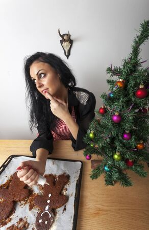 woman baking a gingerbread man Stock Photo - 17137003