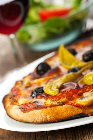 closeup of a pizza with red wine Stock Photo - 17018524