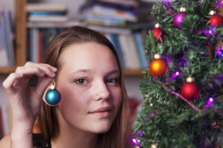 young woman decorating for christmas  Stock Photo - 17137002