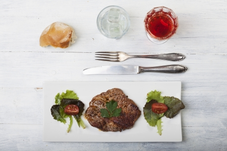 steak with bread and salad  photo