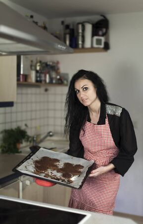 woman in a kitchen with gingerbread  photo
