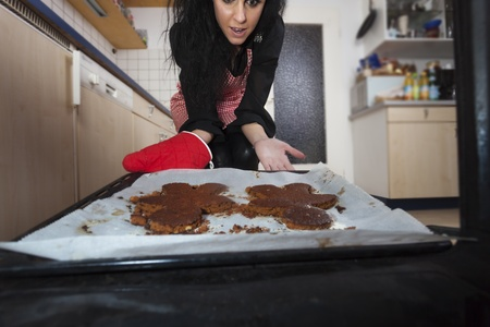 woman in a kitchen with gingerbread Stock Photo - 17137007