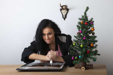 woman in a kitchen with gingerbread Stock Photo - 17136997