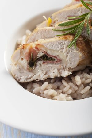 slices of stuffed chicken breast on risotto  Stock Photo - 17018506