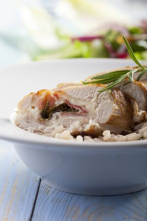 slices of stuffed chicken breast on risotto  Stock Photo - 17086802